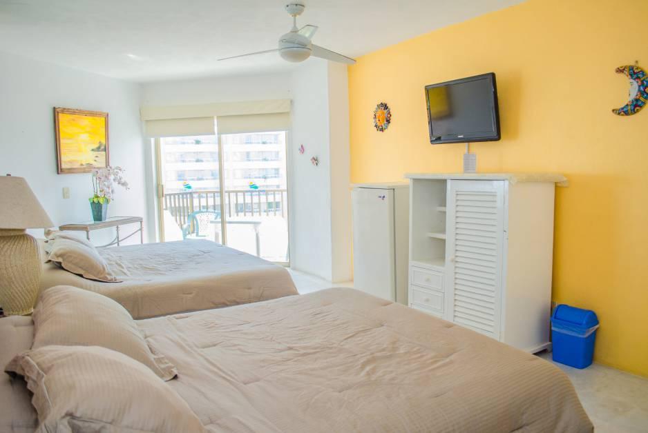 Renta de Habitaciones Vacacionales tipo Estudio en Ixtapa Zihuatanejo, al interior del Hotel Tesoro Ixtapa, vista al mar garantizada, con acceso a la Playa El Palmar Ixtapa y con alberca | Enna Inn Ixtapa